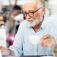 older gentleman drinking coffee