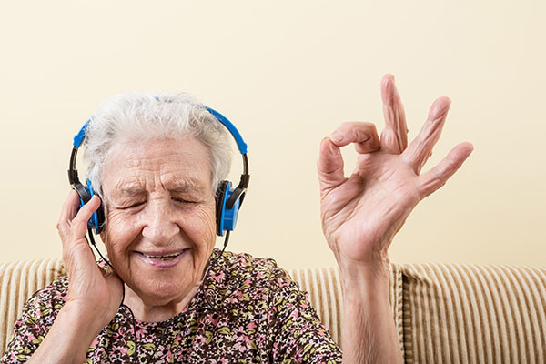 older woman with headphones