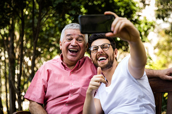 father and son taking a selfie