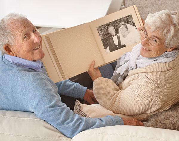 older couple looking through photo album