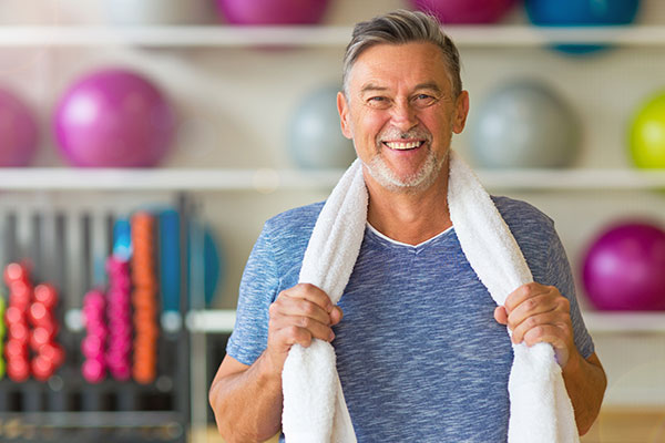 man with workout towel